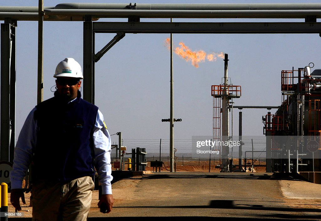An employee walks in front of a gas flare at the In Salah Ga : News Photo