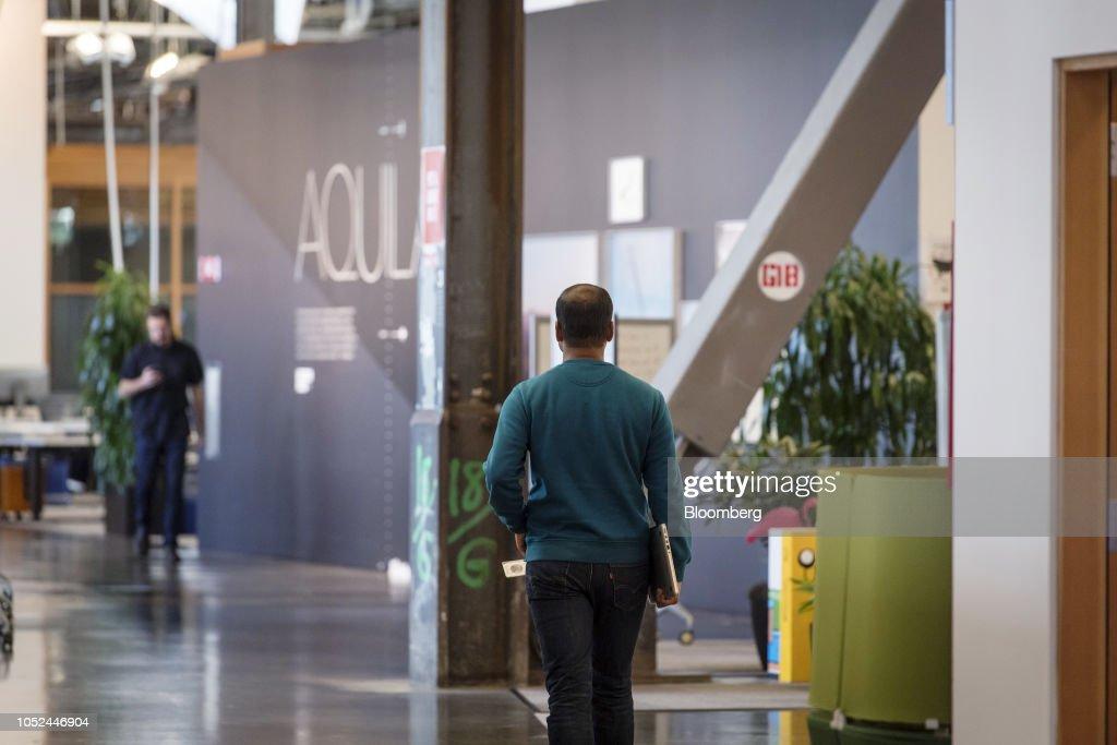 An employee walks inside Facebook Inc  headquarters in Menlo Park