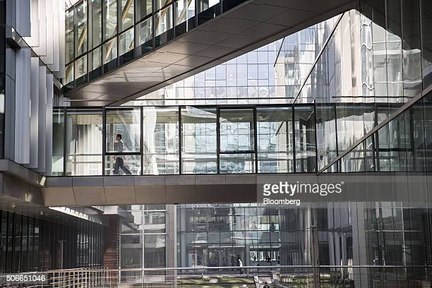 An employee walks on an elevated walkway in the Baidu Inc headquarters in Beijing China on Tuesday Jan 19 2016 Wang Jing the senior vice president in...