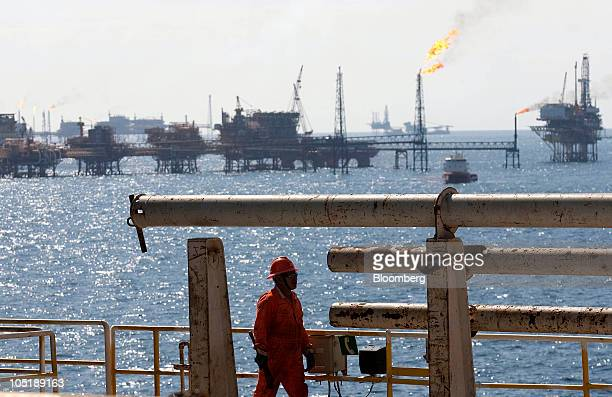 An employee walks on the Tonal oil rig owned by Mexican oil company Pemex located 65 miles northeast of Ciudad del Carmen Campeche in the Gulf of...