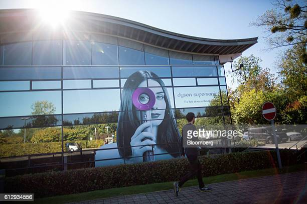 An employee walks past a poster for the Dyson Supersonic hair dryer at the Dyson Ltd campus in Malmesbury UK on Wednesday Oct 5 2016 In addition to...