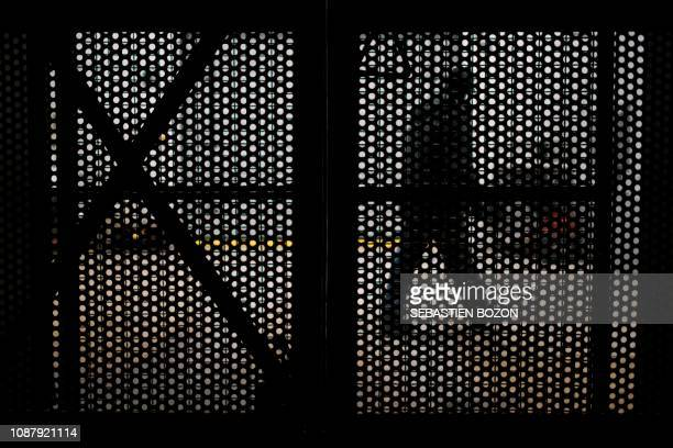 An employee walks past an elevator grid at the StocaMine hazardous waste storage centre in Wittelsheim eastern France on January 24 2019 Some 42000...