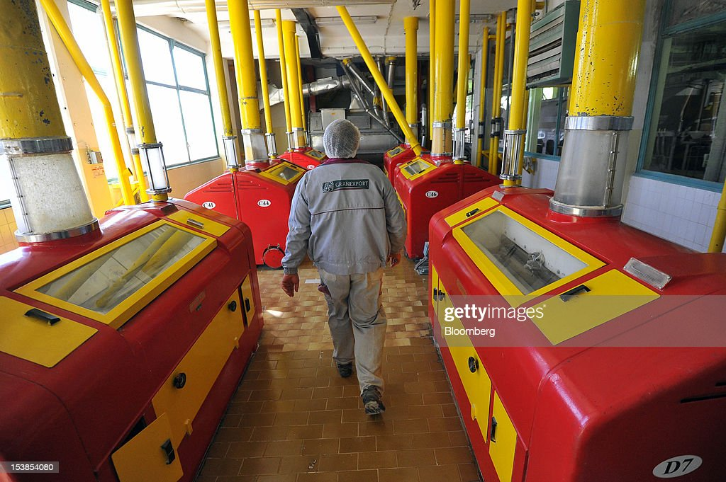 An employee walks past corn milling machines at Granexport AD port, part of MK Group, on the Danube river in Pancevo, Serbia, on Tuesday, Oct. 9, 2012. Goods volumes on Europe's longest river after the Volga are 80 percent lower than on the Rhine, the region's busiest waterway, according to EU figures. Photographer: Oliver Bunic/Bloomberg via Getty Images