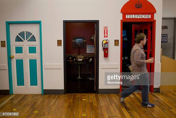 An employee walks past doors to conference room at Etsy Inc headquarters in the Brooklyn borough of New York US on Monday May 4 2015 Etsy Inc a...