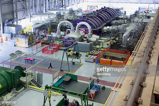 An employee walks past one of the four turbines at the Darlington Nuclear generating station in Bowmanville Ontario Canada on Friday April 1 2016...