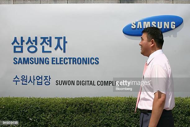 An employee walks past Samsung Electronics Co headquarters in Suwon South Korea on Tuesday June 23 2009 Samsung Electronics Co Asia's biggest maker...