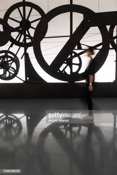 An employee walks past the artwork 'Requim pour une feuille morte' by Swiss artist Jean Tinguely from 1967 at the Kunstpalast museum in Duesseldorf,...
