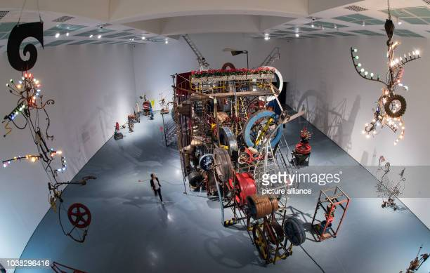 An employee walks past the 'Meta Maxi Maxi Utopia' machine by Swiss artist Jean Tinguely from 1987 at the Kunstpalast museum in Duesseldorf, Germany,...