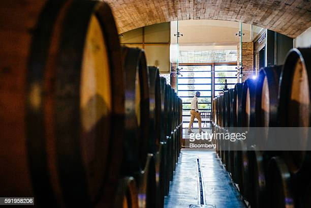 An employee walks past the store of Darnajou French oak wine barrels at the Delaire Graff Estate in Stellenbosch South Africa on Thursday Aug 18 2016...