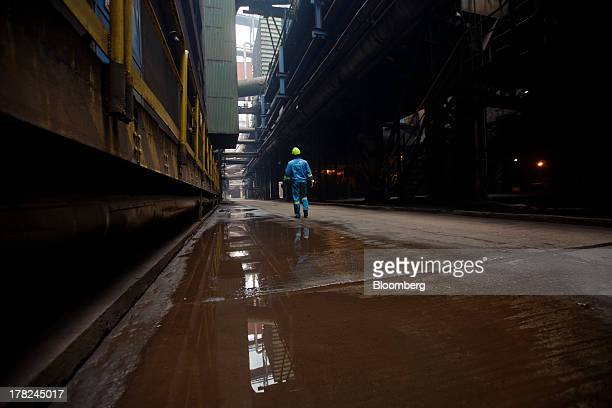 An employee walks through a passageway at ArcelorMittal's steel plant in Ostrava, Czech Republic, on Monday, Aug. 26, 2013. ArcelorMittal, the...