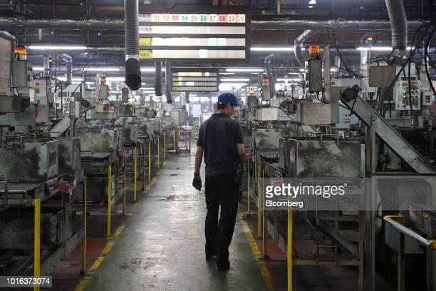 An employee walks through an Asahi Tekko Co factory in Hekinan Aichi Prefecture Japan on Wednesday Aug 1 2018 Japan's government announced last...