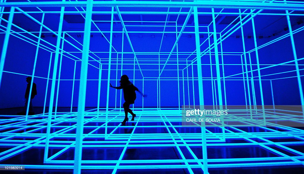An employee walks through British artist Antony Gormley's new installation, Breathing Room III, during a photocall for his new exhibition 'Test Sites' at the White Cube Gallery, London on June 3, 2010. The exhibition is set to run until July 4.