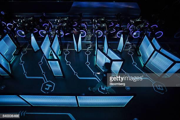 An employee walks through the boarding area for the Tron Lightcyle Power Run rollercoaster at Walt Disney Co's Shanghai Disneyland theme park during...