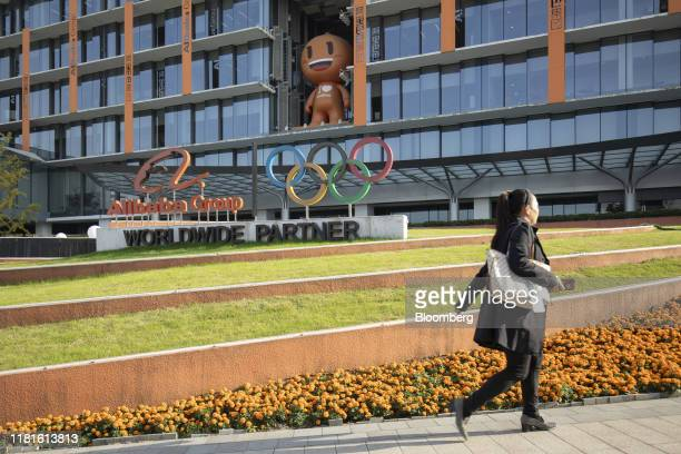 An employee walks through the campus of the Alibaba Group Holdings Ltd headquarters during the annual November 11 Singles' Day online shopping event...