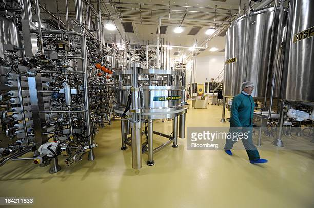 An employee walks through the chromatography processing section of the CSL Behring plasma processing facility a unit of CSL Ltd in Melbourne...