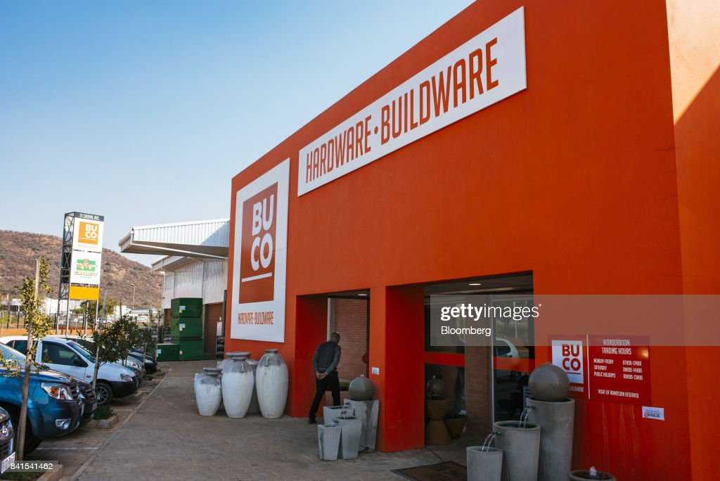 An employee walks through the entrance to a Buco hardware-buildware store, operated by Steinhoff International Holdings NV, in Johannesburg, South Africa, on Thursday, Aug. 31, 2017. Steinhoff said like-for-like sales rose 8 percent as the South African furniture and clothing retailer achieved gains in its core European and African markets. Photographer: Waldo Swiegers/Bloomberg via Getty Images