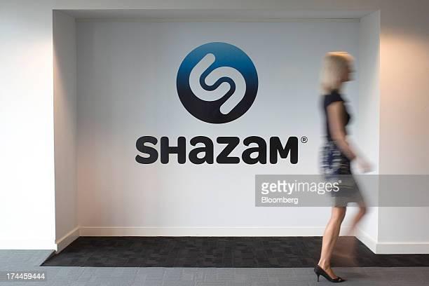 An employee walks through the lobby of the Shazam Entertainment Ltd headquarters in London UK on Friday July 26 2013 Billionaire Carlos Slim's...
