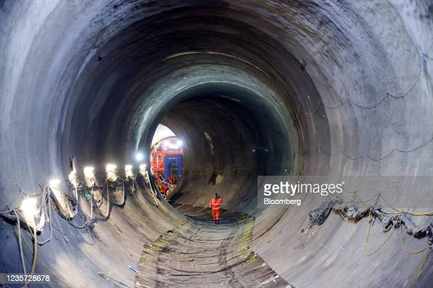 An employee walks through the main tunnel at the Thames Tideway Tunnel super sewer construction project in London, U.K., on Wednesday, Oct. 6, 2021....