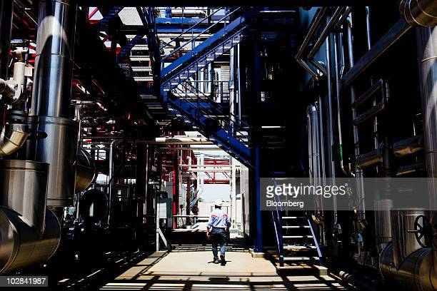 An employee walks through the world's first industrialscale hydrogen plant owned by Enel SpA in Fusina near Venice Italy on Monday July 12 2010 Enel...