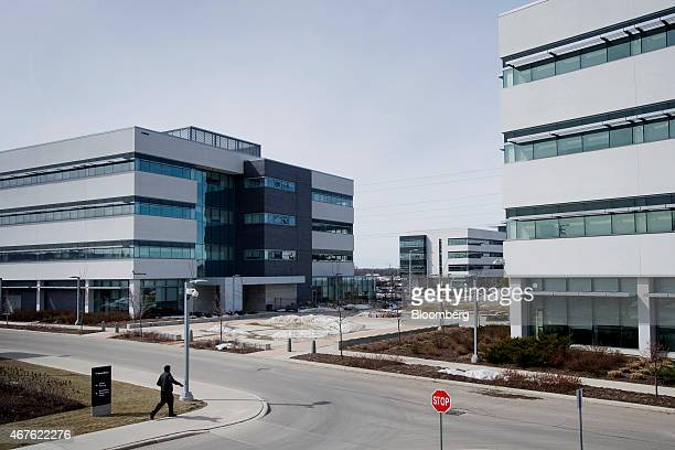 An employee walks towards buildings at BlackBerry Ltd headquarters in Waterloo Ontario Canada on Thursday March 19 2015 BlackBerry Ltd introduced a...