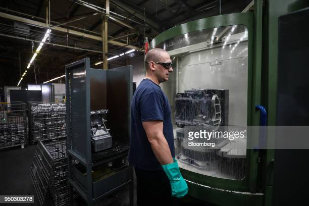 An employee watches as a metal is cut at Liberty Aluminium Technologies in Coventry UK on Monday April 23 2018 Aluminum markets are still reeling...