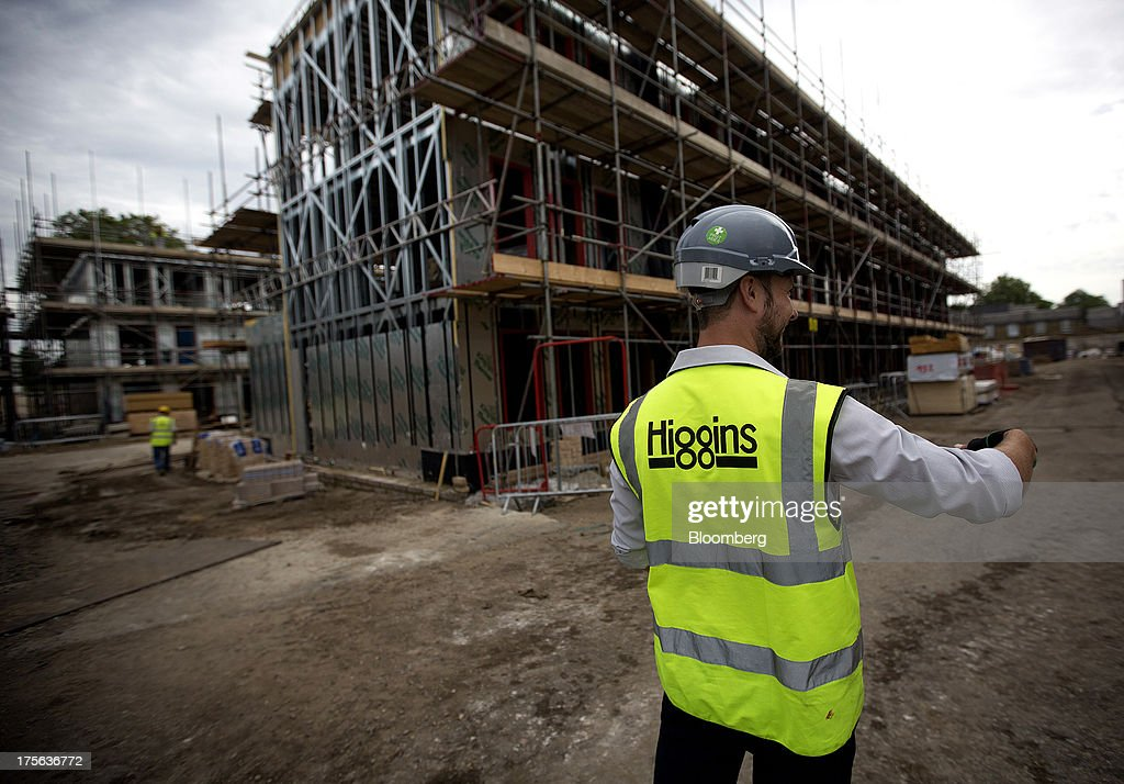 An employee wearing a high-visibility vest works at the Oval Quarter, a shared ownership, private and social residential housing complex developed by Higgins Group Plc in partnership with Nottinghill Housing and Pinnacle Regeneration Group, in London, U.K., on Monday, Aug. 5, 2013. U.K. house prices rose 0.8 percent in July, from 0.3 percent the previous month, Nationwide Building Society said. Photographer: Simon Dawson/Bloomberg via Getty Images