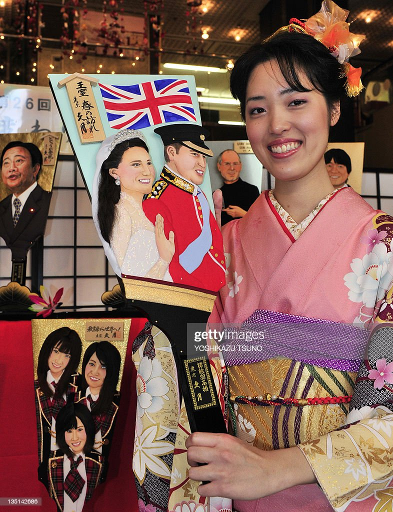 An employee wearing a kimono dress of Japanese doll maker