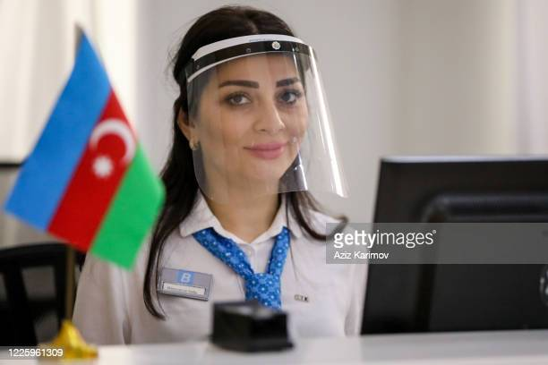 An employee wearing a protective face mask inside ASAN service in Baku on May 20 2020 in Baku Azerbaijan The coronavirus outbreak has infected more...