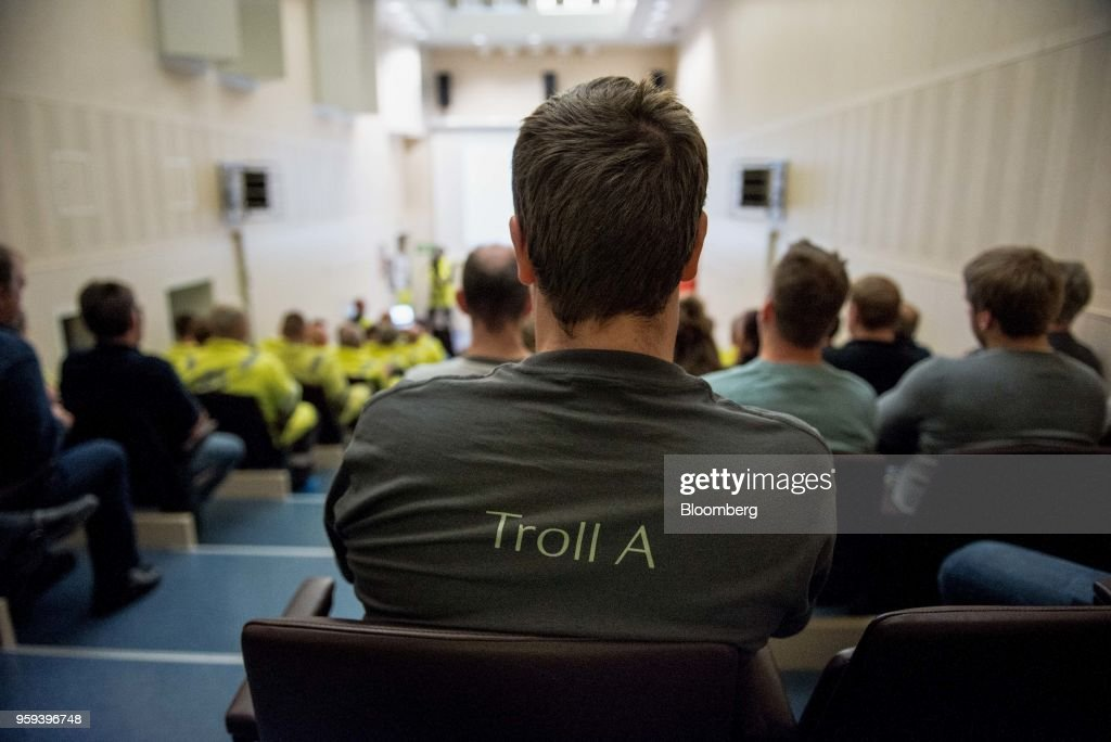 An employee wearing a t-shirt with 'Troll A' written on the back listens to a briefting on board the Troll A natural gas platform, operated by Equinor ASA, in the North Sea, Norway, on Wednesday, May 16, 2018. Statoil has changed its name toEquinorto reflect its mutation into a broader energy company.Photographer: Carina Johansen/Bloomberg via Getty Images