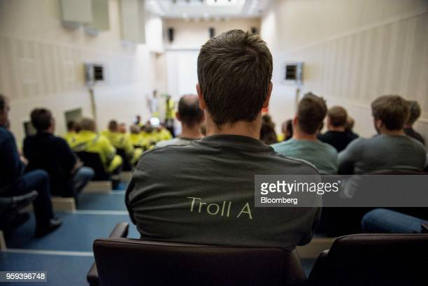 An employee wearing a tshirt with 'Troll A' written on the back listens to a briefting on board the Troll A natural gas platform operated by Equinor...