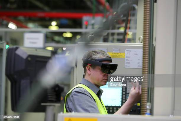 An employee wears a pair of Hololens 3D glasses during an Industry 40 presentation at the ZF Friedrichshafen AG automobile component factory in...