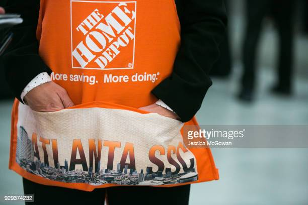 An employee wears an apron to the meeting with House Speaker Paul Ryan during a visit to The Home Depot Store Support Center on March 8, 2018 in...