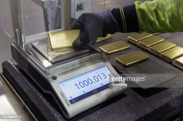 An employee weighs a one kilogram gold bar at the Perth Mint Refinery operated by Gold Corp in Perth Australia on Thursday Aug 9 2018 Demand for...