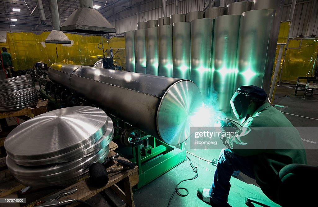 An employee welds an end cap onto an aluminum pontoon during the fabrication process at the Nautic Global Group production facility in Elkhart, Indiana, U.S., on Tuesday, Dec 4, 2012. The U.S. Census Bureau is scheduled to release factory orders data on Dec. 5. Photographer: Ty Wright/Bloomberg via Getty Images