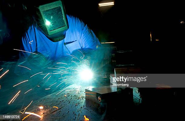 An employee welds interior pieces together at the Horton Emergency Vehicles facility in Grove City Ohio US on Friday Aug 3 2012 Horton Emergency...
