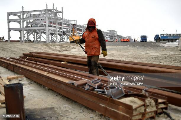 An employee welds reinforcing steels at the construction site of a gas processing plant at the port of Sabetta in the Kara Sea shore line on the...
