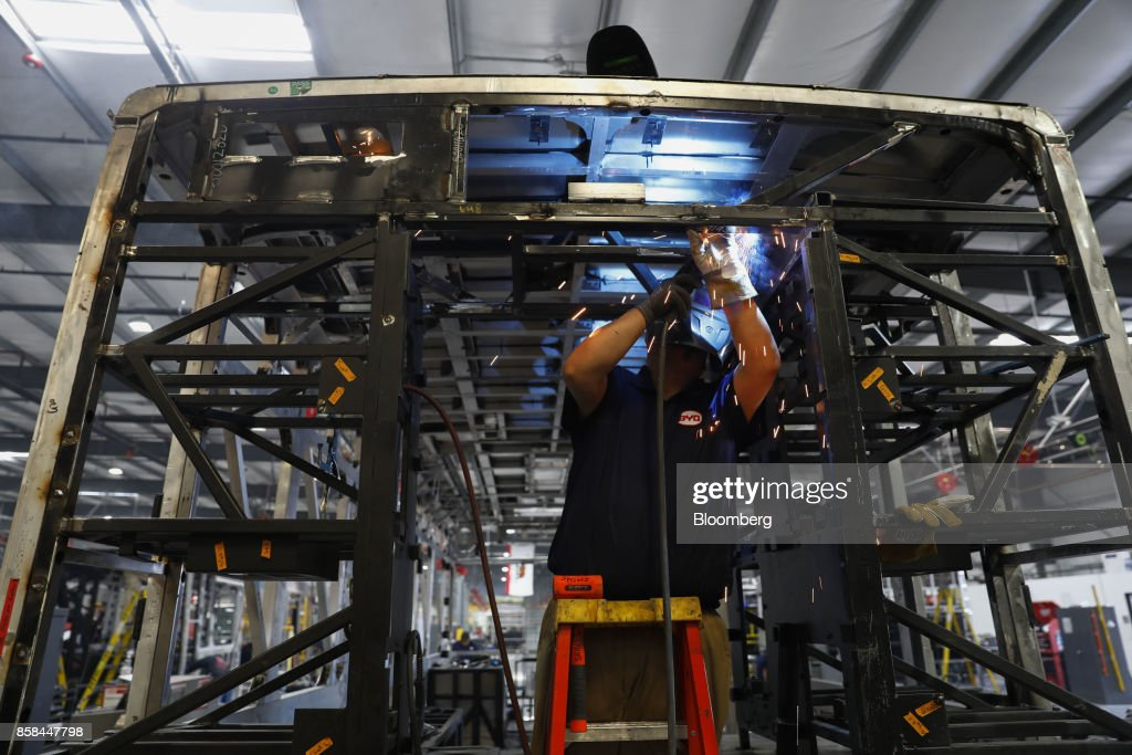 An employee welds the frame of an electric vehicle at the BYD Coach and Bus factory in Lancaster, California, U.S., on Thursday, Oct. 5, 2017. BYD unveiled the newly expanded 450,000 square foot factory on Friday, North America's largest electric bus manufacturing facility. Photographer: Patrick T. Fallon/Bloomberg via Getty Images