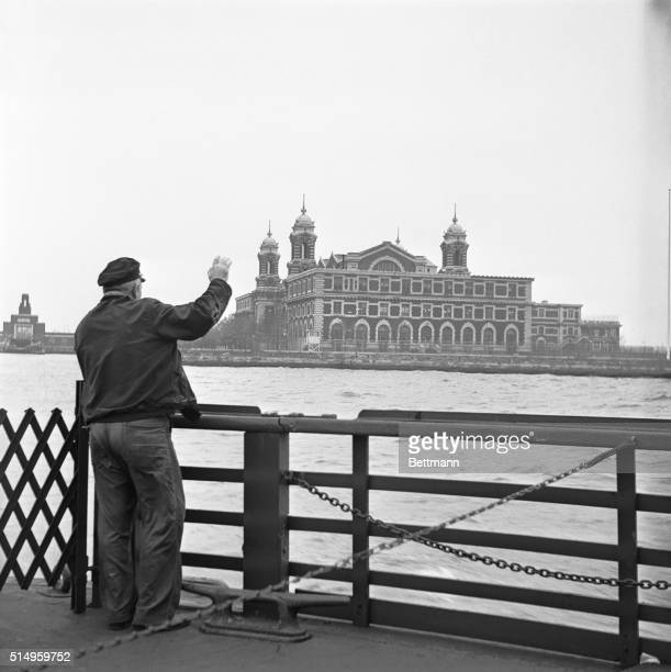 An employee who had worked for the U S Immigration Service for 30 years waves goodbye to Ellis Island as the last ferry pulled out November 12th The...