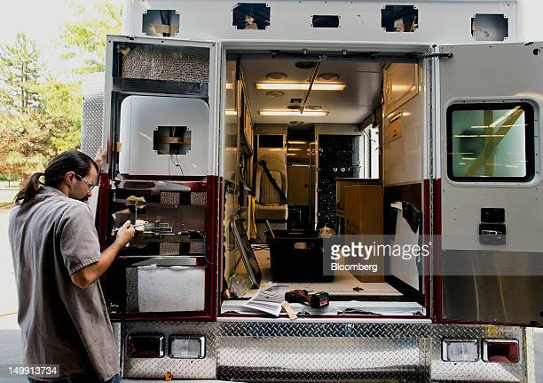 An employee wires up a lock in the rear door of an ambulance module at the Horton Emergency Vehicles facility in Grove City Ohio US on Friday Aug 3...