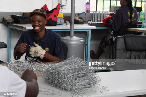 An employee with the project Consol Solar Jar bends a wire in a factory in Johannesburg South Africa 06 February 2017 Preserving jars are the plain...