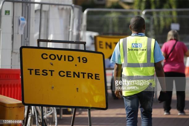 An employee working with the NHS test and trace programme staffs a covid-19 testing centre in north London on September 16, 2020. - The British...