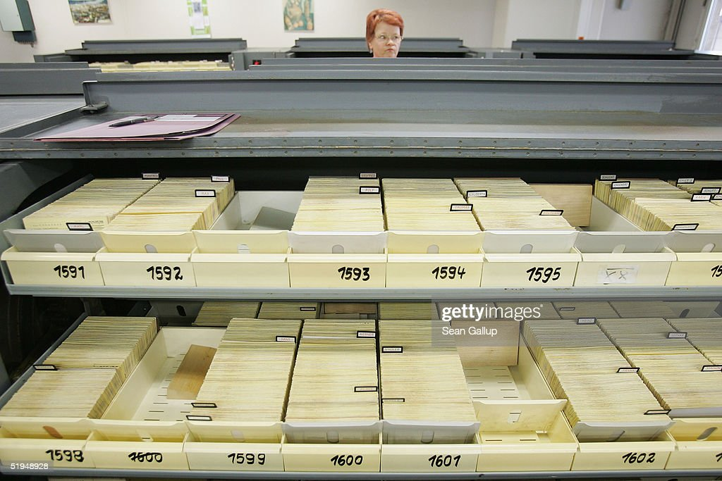An employee works among the 5.1 milion data cards, each card representing one person, in the massive archives of the former Stasi, the secret police of the former East Germany January 13, 2005 in Berlin, Germany. Saturday, January 15, will mark the 15th anniversary of the storming of Stasi headquarters in Berlin by citizens in 1990, when the communist East German regime fell. The Stasi kept detailed records on millions of East Germans in a staggering volume of documents, most of which survive in today's archive. Over 90,000 people still apply evey year to see the files the Stasi kept on them.
