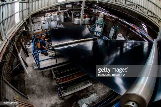 An employee works at a plastic recycling center in San Joaquin de Flores province of Heredia Costa Rica on June 27 2018 Costa Rica discards 564 tons...