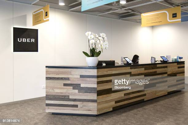 An employee works at a reception desk at the Uber Technologies Inc office in Singapore on Friday Jan 19 2018 The San Franciscobased company is...