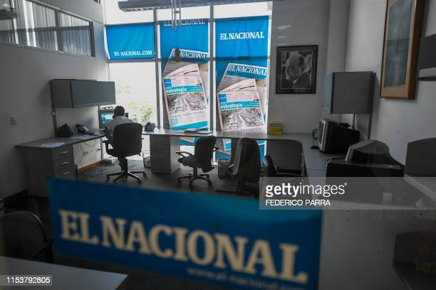 An employee works at a room of Venezuelan newspaper El Nacional in Caracas on June 14 2019 Due to the shortage of paper and scarce personnel the...