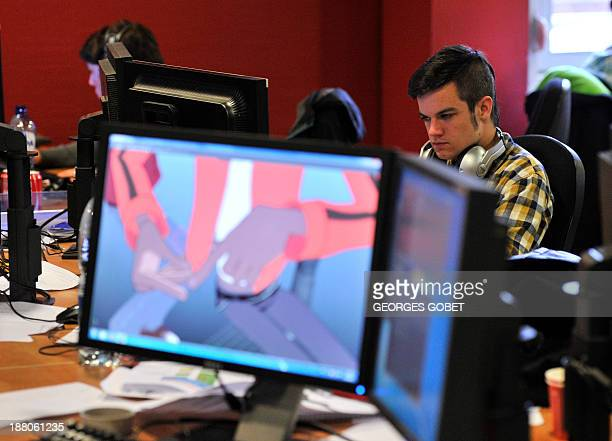 An employee works at Dupuis publishing house's Audiovisual Department on November 7 2013 in Marcinelle district in Charleroi '3D' is the next...