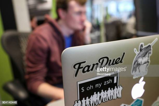 An employee works at his desk at Fanduel Inc's offices in Edinburgh UK on Tuesday Feb 7 2017 More coders are choosing to live in Edinburgh over...