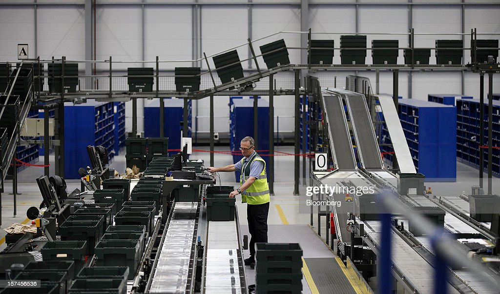 An employee works at John Lewis Plc's semi-automated distribution centre in Milton Keynes, U.K., on Monday, Dec. 3, 2012. An index of U.K. retail sales rose to a five-month high in November, according to a monthly report from the Confederation of British Industry. Photographer: Simon Dawson/Bloomberg via Getty Images