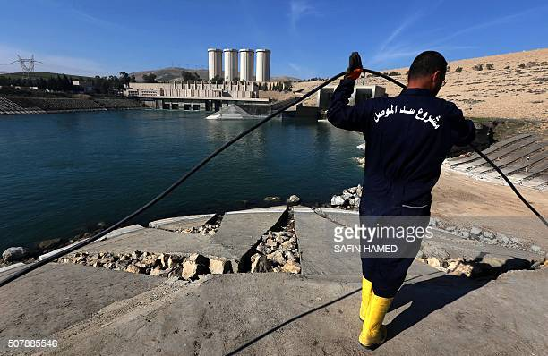An employee works at strengthening the Mosul Dam on the Tigris River around 50 kilometres north of the Iraqi city of Mosul on February 1 2016 The...