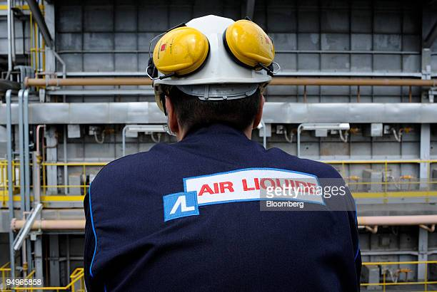 An employee works at the Air Liquide hydrogen plant in Port Jerome France on Friday July 24 2009 The company announces its earnings next week
